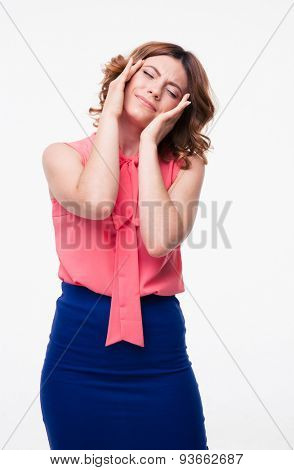 Casual woman having headache isolated on a white background