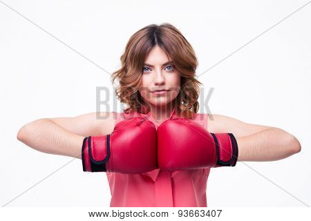 Cute elegant woman with boxing gloves isolated on a white background. Looking at camera