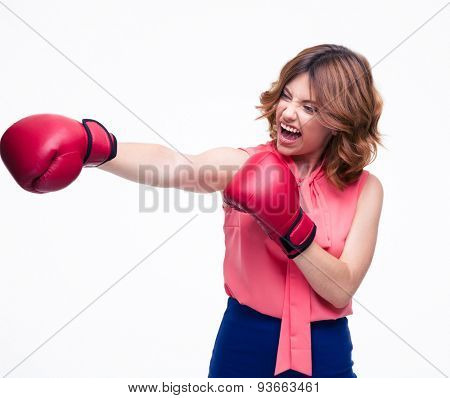 Angry elegant woman with boxing gloves fighting isolated on a white background