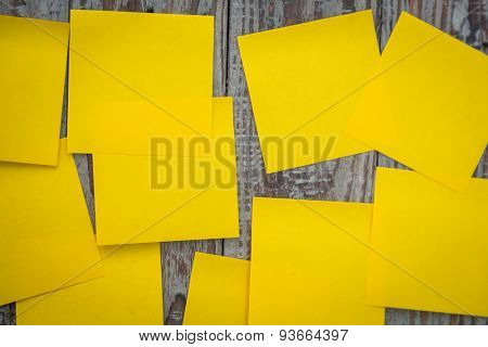 Yellow sticky note on wooden board