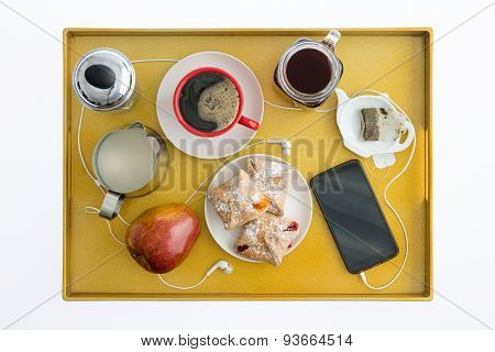 Smart Phone With Earbuds On Breakfast Tray