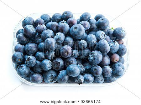 Blueberry in a plastic pack isolated on white background. top view