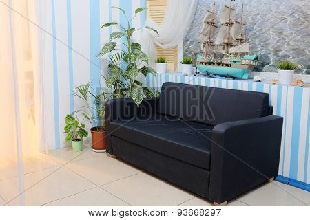 Interior of a waiting room with a sofa
