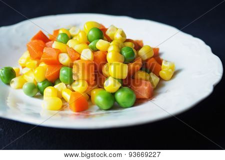 Cooked Vegetables On A White Plate