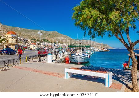 Port with bench and moored boat on Kalymos, Greece