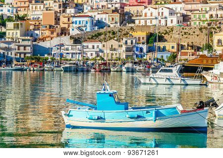 Small colorful fishermen's boat in cosy Greek Port