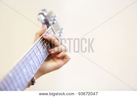 Woman Musician Holding A Guitar, Playing A G Chord
