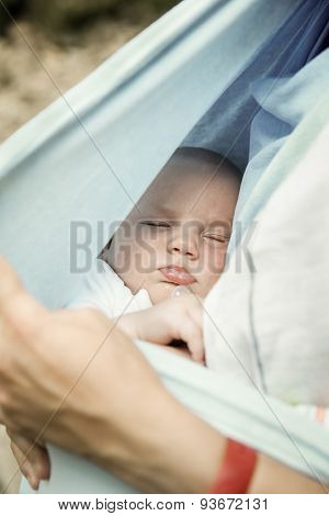 Portrait Of A Sleeping Baby Boy, Resting In Mothers Arms