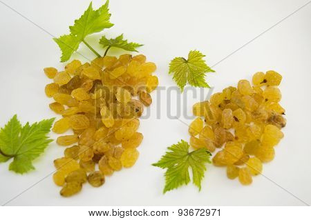 Raisins Forming A Cluster On White Background