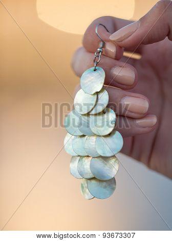 Assortment of jewelry in woman hand, macro photo.