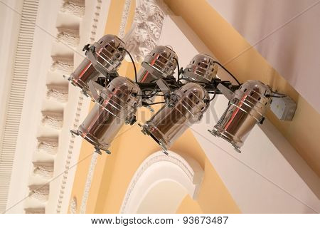 Equipment For Stage Lighting, Hanging On The Wall In The Concert Hall