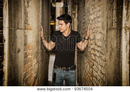 Man pressed between two walls. Concept of oppression, anxiety