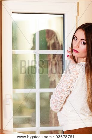 Beautiful Woman Looking Through Window.