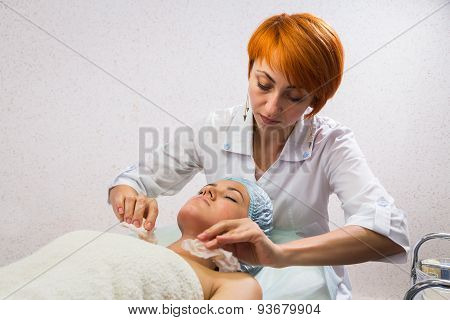 Girl with a beautician at spa salon.