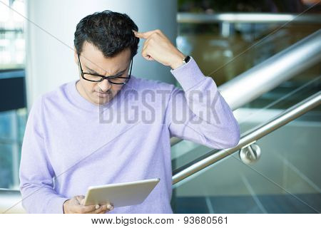Man Confused By What He Sees On Tablet