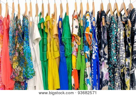 Set of fashion female colorful clothing hanging a on display