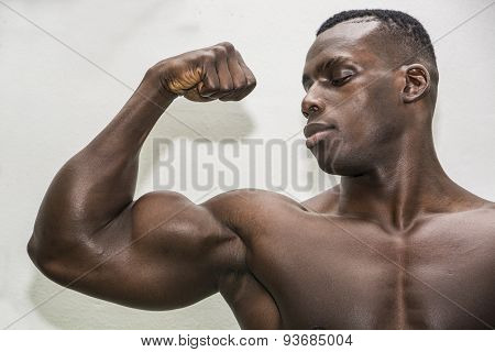 Attractive hunky black male bodybuilder posing