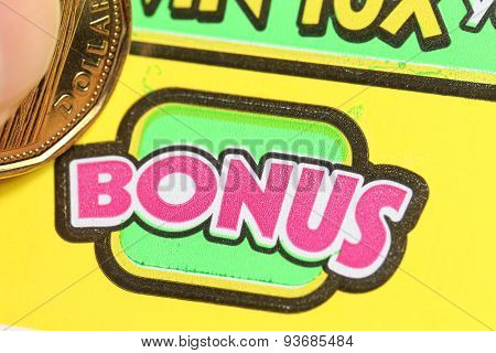 Coquitlam BC Canada - June 04, 2015 : Scratching lottery ticket on bonus. The British Columbia Lottery Corporation has provided government sanctioned lottery games in British Columbia since 1985.