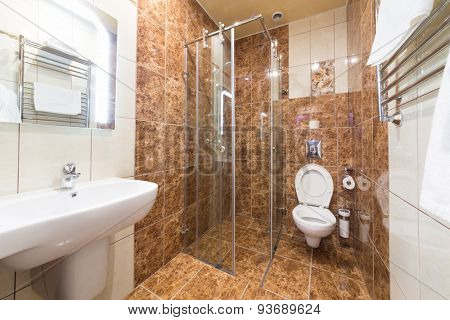 ADLER, RUSSIA - JULY 22, 2014: Interior bathroom of a hotel room with glass shower in Shine House hotel