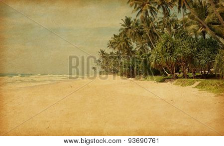 Tropical beach with  palm trees.  Sri Lanka. Photo in retro style. Added paper texture.
