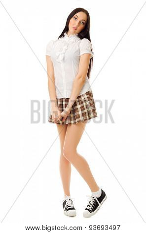Modest school girl in plaid skirt isolated