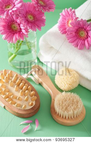 spa aromatherapy with gerbera flowers sponge  brush