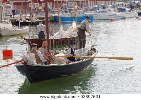 Sailors In Vintage Clothes Using The Oars Old Sailing Ship