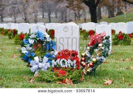 Christmas wreathes rounding a mom soldier's gravestone - Arlington National Cemetery - Washington DC