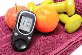 pic of diabetes  - Glucose meter fresh fruits dumbbells for using in fitness lying on purple towel concept for diabetes lifestyle and healthy nutrition - JPG
