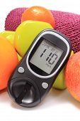 image of diabetes  - Glucometer fresh fruits dumbbells and purple towel for using in fitness concept for diabetes lifestyle and healthy nutrition - JPG