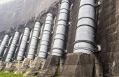 picture of dam  - A large pipe behind the wall of the dam that used to deliver water to generate electricity - JPG