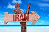 stock photo of tehran  - Iran wooden sign with a Indian Ocean on background - JPG
