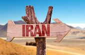 pic of tehran  - Iran wooden sign with desert road background - JPG