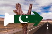 image of civil war flags  - Pakistan Flag wooden sign with desert road background - JPG