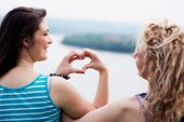 stock photo of  friends forever  - Heart shape made of hands from two best girl friends - JPG