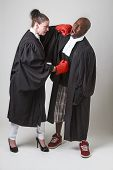 image of toga  - woman and man in canadian lawyer toga having a boxing match - JPG