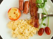 foto of scrambled eggs  - scrambled eggs for breakfast with bacon tomatoes and parsley - JPG