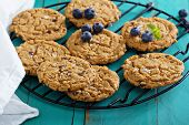 foto of chocolate-chip  - Gluten free chocolate chip cookies made from almond butter on a cooling rack - JPG