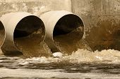 stock photo of naturel  - Toxic water running from sewers to the environment - JPG