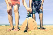 picture of nostalgic  - Best friends ready to play beach tennis game at beginning of summer  - JPG