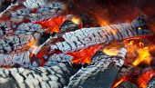 stock photo of brazier  - brightly burning wood in a metal brazier - JPG