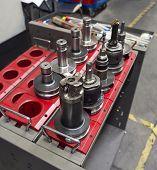 foto of machine  - operator prepare machining holder for machining center - JPG