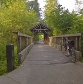 stock photo of covered bridge  - Small wooden covered bridge in Fairview Village Oregon - JPG