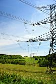 picture of power transmission lines  - Electric high voltage power lines in the landscape - JPG