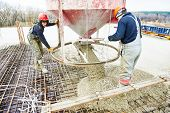 image of concrete pouring  - concreting work - JPG