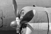stock photo of propeller plane  - the big propeller on the motor of the old plane closeup and a side view in monochrome tones - JPG