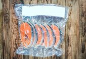 picture of frozen  - Frozen salmon fillets in a vacuum package - JPG