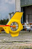 stock photo of helicopters  - Fragment of the yellow modern new helicopter - JPG