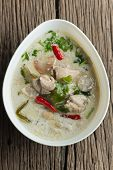 "stock photo of gai  - Coconut milk with chicken. Traditional thai soup ""Tom Kha Gai""