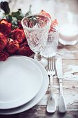 pic of wedding table decor  - Vintage table setting with glasses and cutlery on an old wooden board - JPG